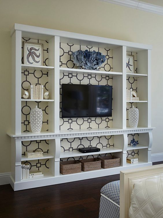 Media cabinet wallpapered