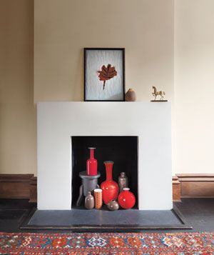fireplace with orange vases
