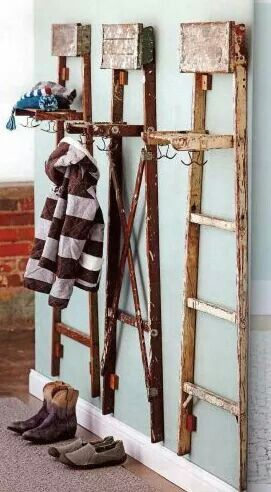 vintage ladders as coat stands